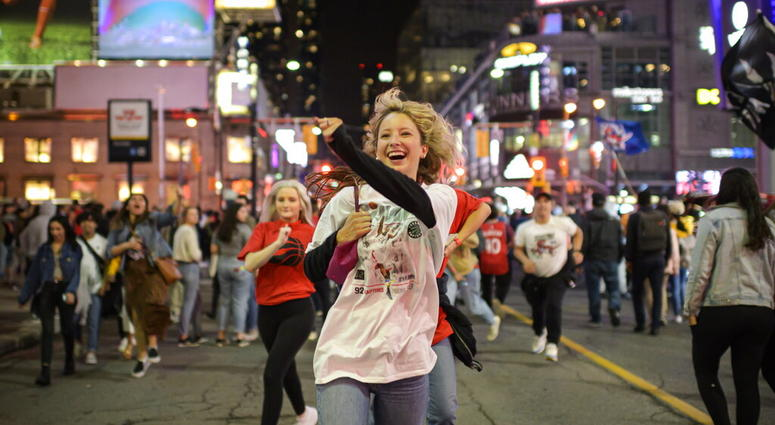 Toronto Raptors supporters celebrate in the streets after the Raptors defeated the Golden State Warriors during Game 6 NBA Finals to win the NBA Championship, in Toronto on Thursday, June 13, 2019.