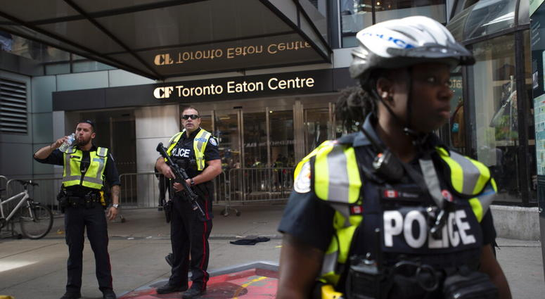 Toronto Police secure the scene where shots were fired during the Toronto Raptors NBA basketball championship parade in Toronto, Monday, June 17, 2019.