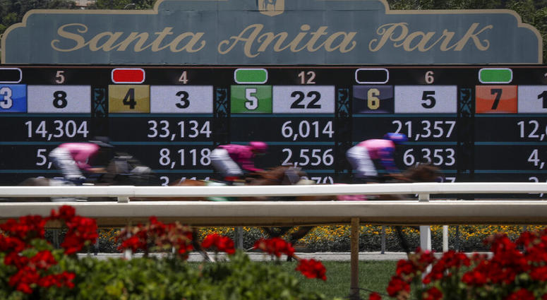 Horses finish the the first race during the last day of the winter/spring meet at the Santa Anita horse racing track Sunday, June 23, 2019, in Santa Anita, Calif.