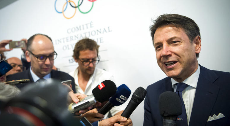 Italian Prime minister Giuseppe Conte speaks to journalists as he arrives during the first day of the 134th Session of the International Olympic Committee