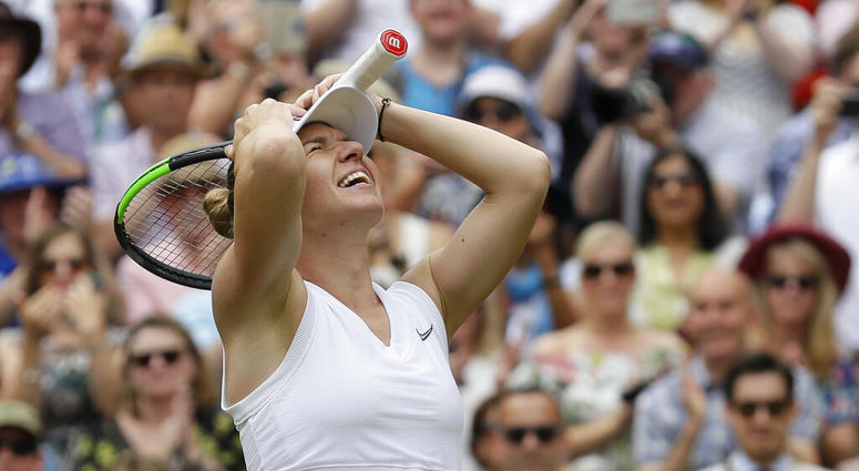 Romania's Simona Halep celebrates after defeating United States' Serena Williams during the women's singles final match on day twelve of the Wimbledon Tennis Championships in London, Saturday, July 13, 2019.