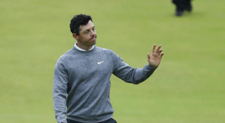 Northern Ireland's Rory McIlroy waves to the crowd as he walks onto the 18th green during the second round of the British Open Golf Championships at Royal Portrush in Northern Ireland, Friday, July 19, 2019.