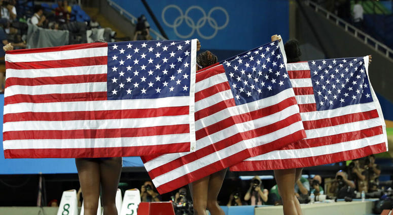 gold medal winner Brianna Rollins, center, silver medal winner Nia Ali, left, and bronze medal winner Kristi Castlin, all from the United States