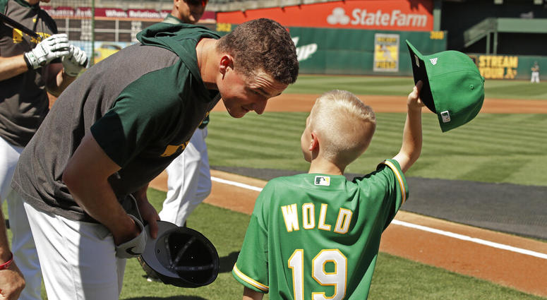 Eight-year-old August Wold (19) compares his haircut to Oakland Athletics' Matt Chapman's