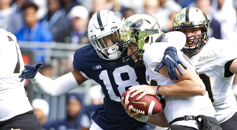 Penn State defensive end Shaka Toney (18) sacks Purdue quarterback Jack Plummer (13) in the first quarter of an NCAA college football game in State College, Pa., on Saturday, Oct. 5, 2019.