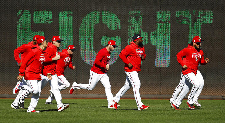 Members of the Washington Nationals participate in a baseball workout, Friday, Oct. 18, 2019, in Washington, in advance of the team's appearance in the World Series.