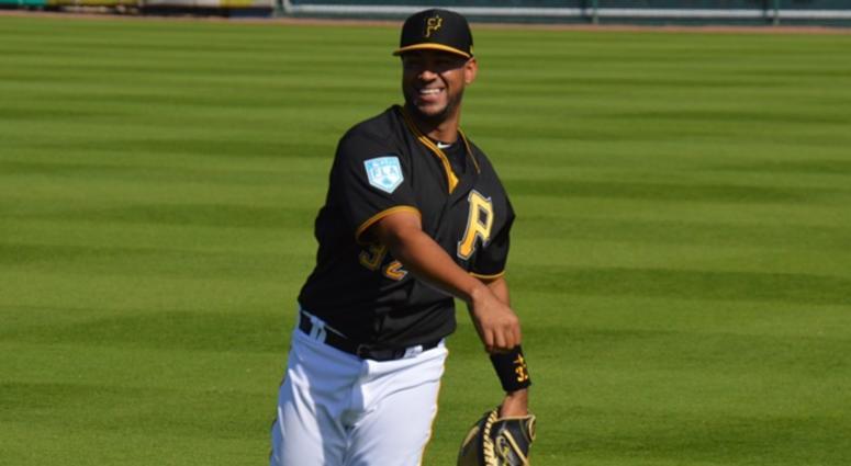 Elias Diaz throwing