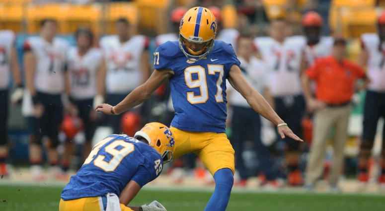 Pittsburgh Panthers place kicker Alex Kessman (97) kicks a fifty-five yard field goal from the hold of Jake Scarton (49) against the Syracuse Orange during the second quarter at Heinz Field.