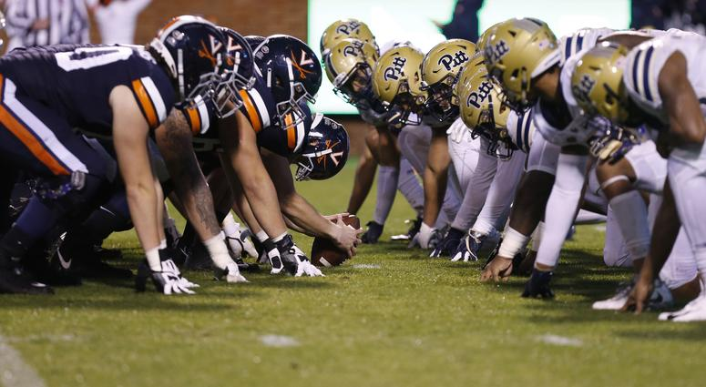 The Virginia Cavaliers offense lines up against the Pittsburgh Panthers defense in the first quarter at Scott Stadium.
