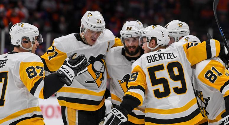 Pittsburgh Penguins defenseman Justin Schultz (4) celebrates his goal with the teammates