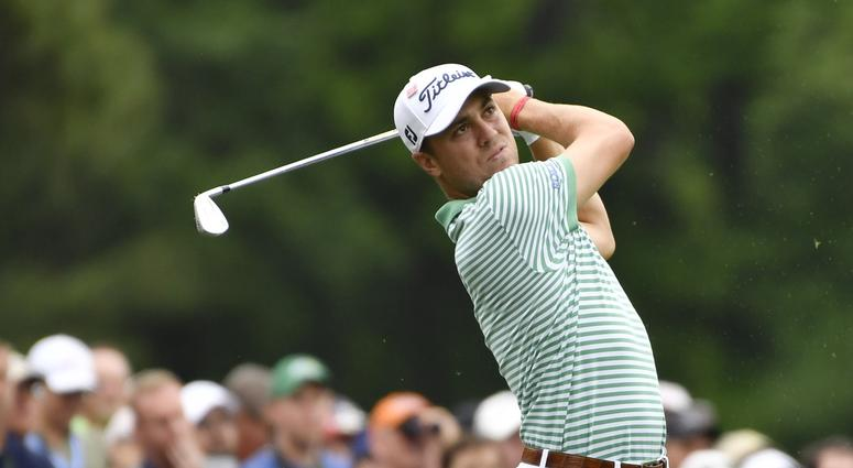 Justin Thomas hits his tee shot on the 12th hole during the final round of The Masters