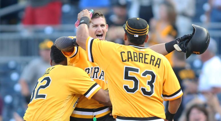 ittsburgh Pirates catcher Elias Diaz (32) and shortstop Kevin Newman (middle) and right fielder Melky Cabrera
