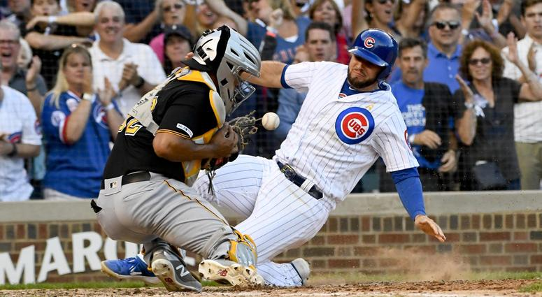 Chicago Cubs third baseman David Bote scores past Pittsburgh Pirates catcher Elias Diaz