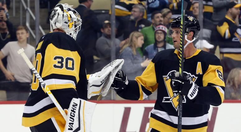 Pittsburgh Penguins goaltender Matt Murray (30) and defenseman Brian Dumoulin (8) celebrate after defeating the Anaheim Ducks at PPG PAINTS Arena. Pittsburgh won 2-1.