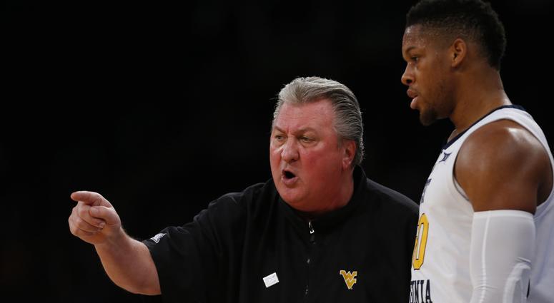 West Virginia Mountaineers head coach Bob Huggins talks to forward Sagaba Konate (50) during the second half against the Florida Gators at Madison Square Garden.