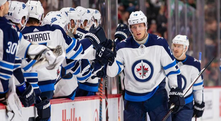Winnipeg Jets forward Patrik Laine (29) celebrates his goal in the first period against Minnesota Wild at Xcel Energy Center.