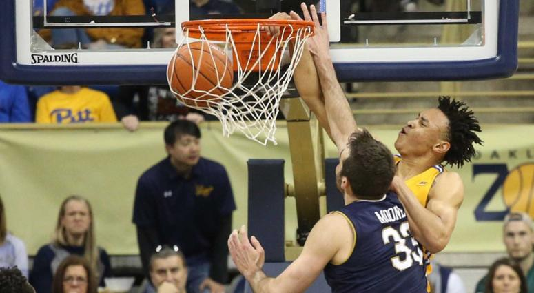 Pittsburgh Panthers guard Trey McGowens (2) dunks against Notre Dame Fighting Irish forward John Mooney (33) during the first half at the Petersen Events Center.