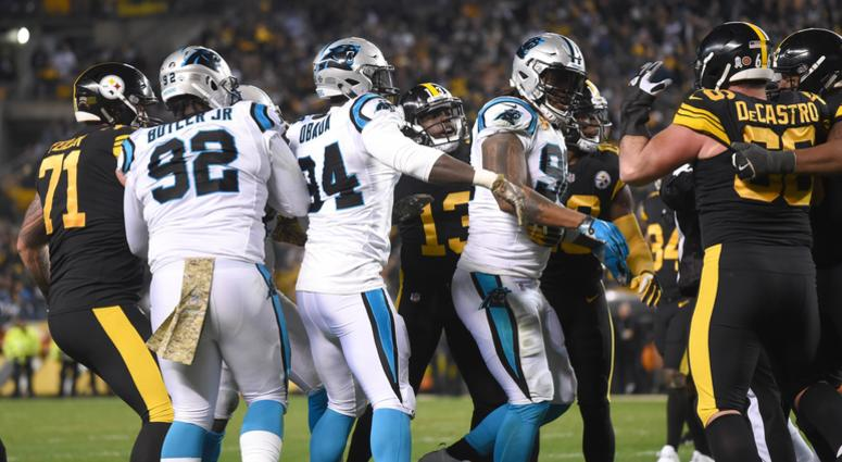 Players from the Pittsburgh Steelers and Carolina Panthers push and shove each other after a hit by Carolina safety Eric Reid against Pittsburgh quarterback Ben Roethlisberger during the third quarter