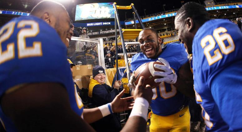 Pittsburgh Panthers running back Darrin Hall (22) hands the game ball to running back Qadree Ollison (30) after the Panthers defeated the Virginia Tech Hokies at Heinz Field. Pittsburgh won 52-22.