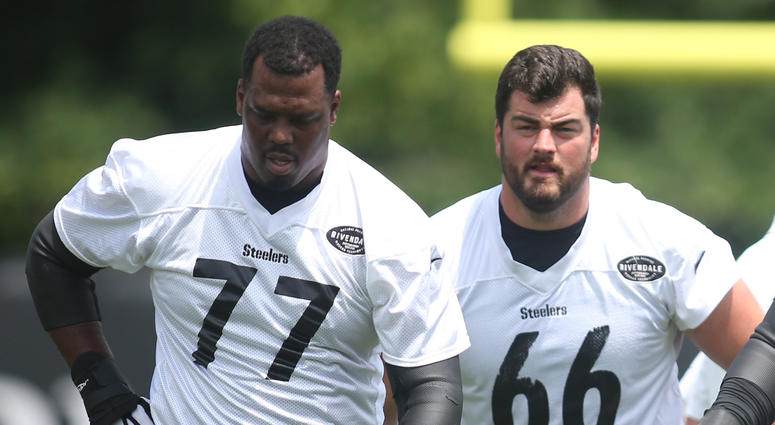 Pittsburgh Steelers offensive lineman Marcus Gilbert (77) and David DeCastro (66) and Maurkice Pouncey (53) and Ramon Foster (73) participate in drills during minicamp at UPMC Rooney Sports Complex.