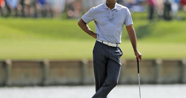 Tiger Woods reacts to hitting his drive into the water on the 17th hole during the second round of The Players Championship golf tournament Friday, March 15, 2019, in Ponte Vedra Beach, Fla