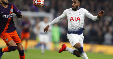 Manchester City's Riyad Mahrez, left, challenges for the ball with Tottenham's Danny Rose during the Champions League, round of 8, first-leg soccer match between Tottenham Hotspur and Manchester City at the Tottenham Hotspur stadium in London, Tuesday, Ap