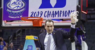 Duke head coach Mike Krzyzewski celebrates Duke's win over Florida State after cutting down a net after the NCAA college basketball championship game of the Atlantic Coast Conference tournament in Charlotte, N.C., Saturday, March 16, 2019