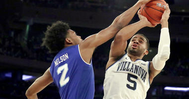 Villanova guard Phil Booth (5) goes up for a shot against Seton Hall guard Anthony Nelson