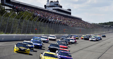 Daniel Suarez (19) leads the field into Turn 1 to start a NASCAR Cup Series auto race