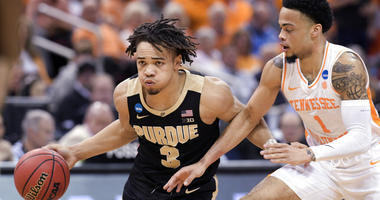 Purdue's Carsen Edwards (3) is defended by Tennessee's Lamonte Turner (1) during the second half of a men's NCAA Tournament college basketball South Regional semifinal game Thursday, March 28, 2019, in Louisville, Ky.