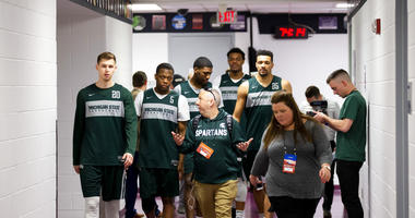 Michigan State guard Matt McQuaid, left, guard Cassius Winston, forward Aaron Henry, forward Xavier Tillman and forward Kenny Goins walk to an NCAA men's college basketball individual news conferences in Washington, Saturday, March 30, 2019. Michigan Stat