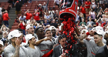Texas Tech players shower coach Chris Beard with confetti after their win against Gonzaga during the West Regional final in the NCAA men's college basketball tournament Saturday, March 30, 2019, in Anaheim, Calif. Texas Tech won 75-69.