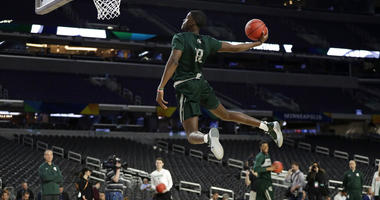 Michigan State forward Gabe Brown dunks the ball during a practice session for the semifinals of the Final Four NCAA college basketball tournament, Friday, April 5, 2019, in Minneapolis.