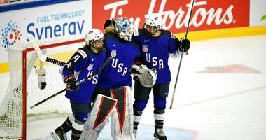 Brianna Decker, left, Alex Rigsby and Cayla Barnes of USA celebrate winning the 2019 IIHF Women's World Championships preliminary match between USA and Canada in Espoo, Finland, Saturday April 6, 2019.