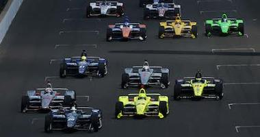 IndyCars Racing At Indianapolis Motor Speedway