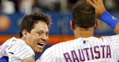 New York Mets' Wilmer Flores and Jose Bautista