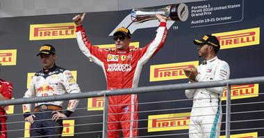 Ferrari driver Kimi Raikkonen holds the trophy after winning the Formula One U.S. Grand Prix