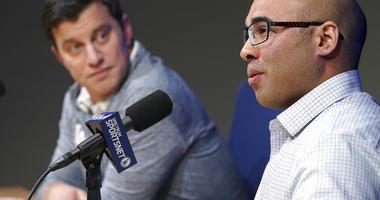 Los Angeles Dodger general manager Farhan Zaidi talks as President of Baseball Operations Andrew Friedman,