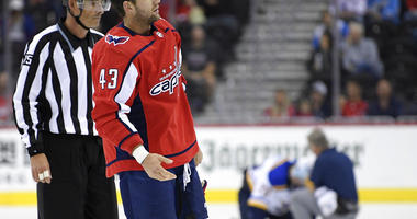 Washington Capitals Tom Wilson is escorted by an official off the ice after he checked St. Louis Blues Oskar Sundqvist