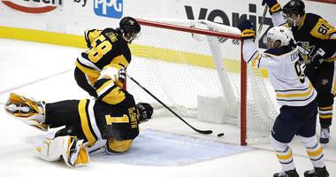 Buffalo Sabres' Jack Eichel (9) celebrates his game-winning overtime goal past Pittsburgh Penguins goaltender Casey DeSmith