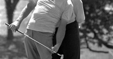 comedian Bob Hope lends aid to Jack Nicklaus in lining up Nicklaus' putt on the first green during the pro-am play of the Byron Nelson Classic in Dallas
