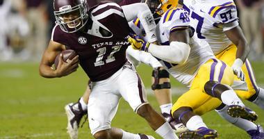 Texas A&M quarterback Kellen Mond (11) is sacked by LSU linebacker Devin White
