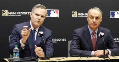 MGM Resorts CEO James Murren, left, and MLB Commissioner Rob Manfred speak during a news conference at MLB headquarters in New York