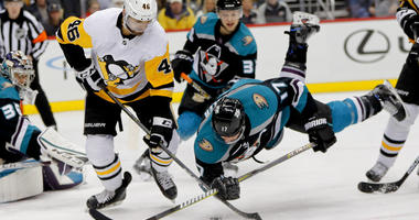 Anaheim Ducks' Ryan Kesler (17) tumbles as he and Pittsburgh Penguins' Zach Aston-Reese