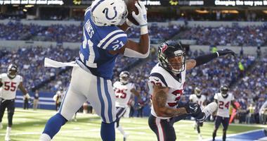 Indianapolis Colts' Nyheim Hines (21) makes a touchdown reception against Houston Texans' Tyrann Mathieu