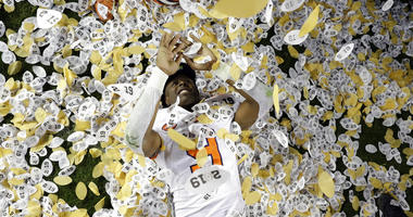 Clemson's Travis Etienne celebrates after the NCAA college football playoff championship game