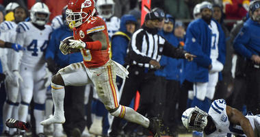 Kansas City Chiefs players celebrate after linebacker Justin Houston (50) recovered a ball fumbled by Indianapolis Colts quarterback Andrew Luck