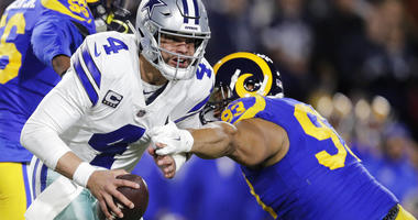Dallas Cowboys quarterback Dak Prescott breaks away from Los Angeles Rams