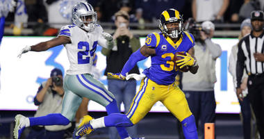 Los Angeles Rams running back Todd Gurley scores past Dallas Cowboys