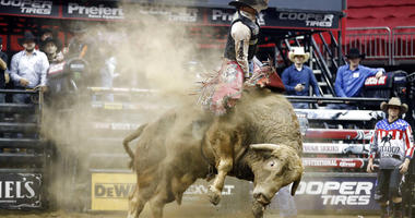 Mason Lowe rides Cochise during a Professional Bull Riders